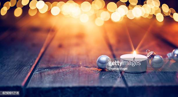 Christmas candle and ornaments on  table - Defocused Blue wood