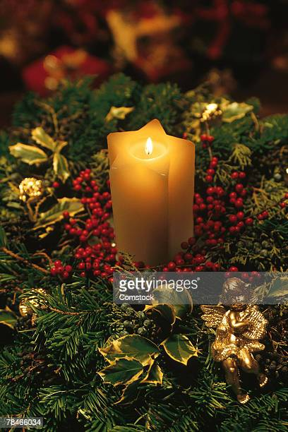 Christmas candle with evergreen decorations