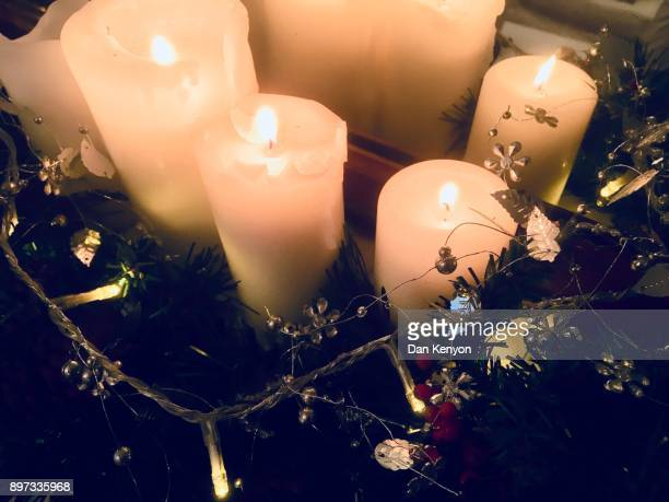 Christmas candles and lights on mantlepiece