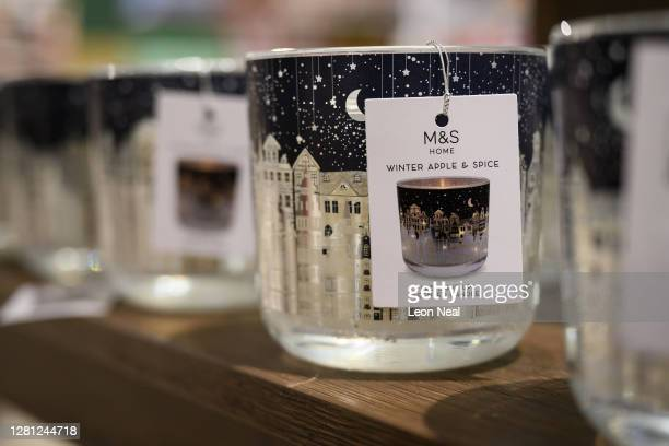 Christmas candles are seen among some of the festive items in the Christmas gift and decoration section in the branch of retailer Marks and Spencer...