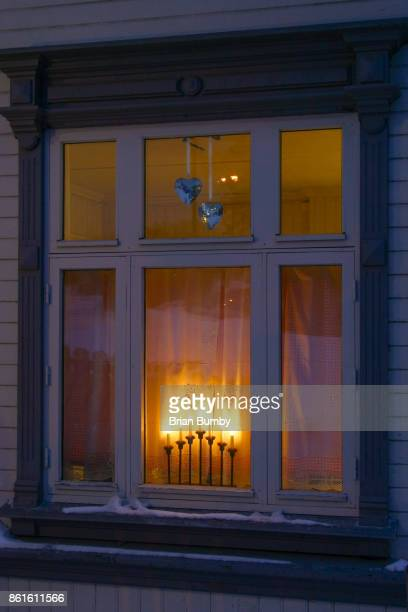 christmas candles in window, tromso, norway - brian sills stock pictures, royalty-free photos & images