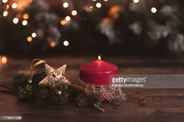 christmas candles on a red background - advent calendar stock photos and pictures