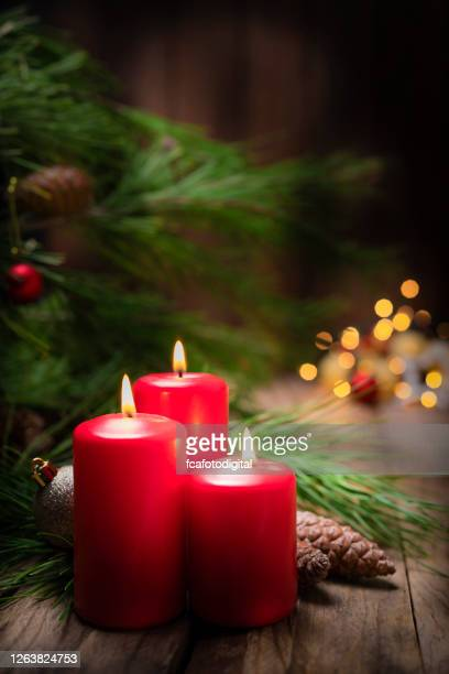 christmas candles on rustic wooden table. copy space - christmas decore candle stock pictures, royalty-free photos & images