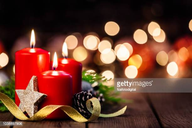 christmas candles on rustic wooden table - candle stock pictures, royalty-free photos & images