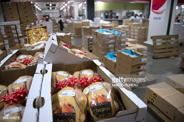 Christmas capons are displayed at the Rungis food market on December 20 2013 in Rungis outside Paris AFP PHOTO MARTIN BUREAU