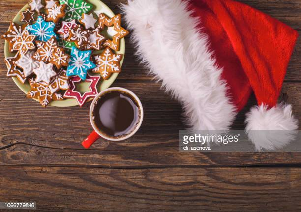 christmas cappuccino and gingerbread cookies on rustic wooden table - christmas cookies stock pictures, royalty-free photos & images