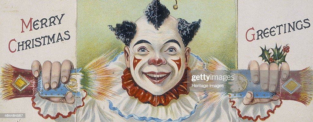 Christmas card; clown pulling a cracker, early 20th century. : News Photo