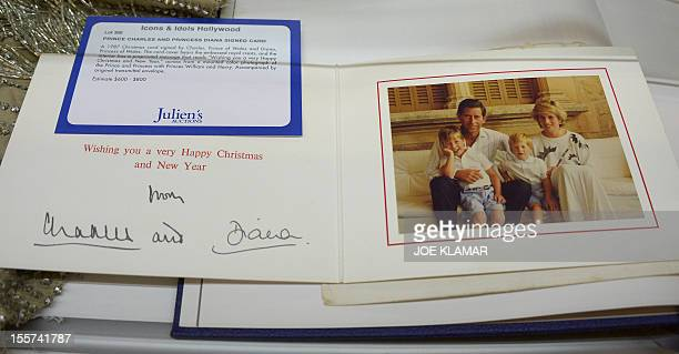 'MANDATORY MENTION OF THE ARTIST UPON PUBLICATION' Christmas card from Prince Charles and Lady Diana is displayed at Julien's Auctions in Beverly...
