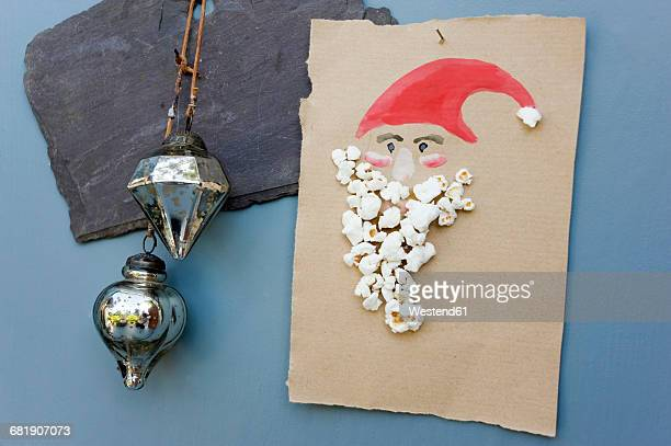 christmas card made of water colours and popcorn - santa face stock pictures, royalty-free photos & images