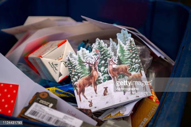 christmas cards and wrapping in outdoor recycling bin - equipamento à base de papel imagens e fotografias de stock