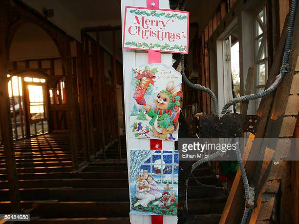 Christmas cards are seen after Mary Davis decorated her son Michael's house in the Lakeview District December 23, 2005 in New Orleans, Louisiana....