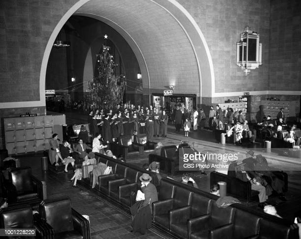 Christmas carolers at Los Angeles Union Passenger Terminal They perform a segment to be included in a special CBS Radio broadcast Christmas Sing with...