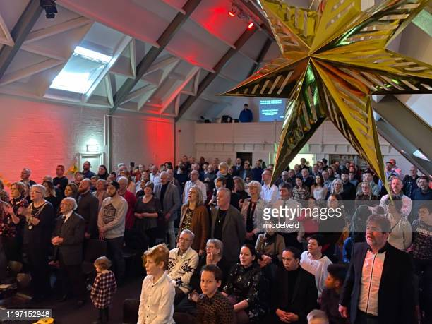 christmas ceremony in church - concert hall stock pictures, royalty-free photos & images
