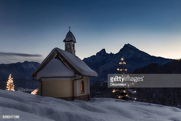 christmas chapel in front of watzmann - country christmas stock pictures, royalty-free photos & images