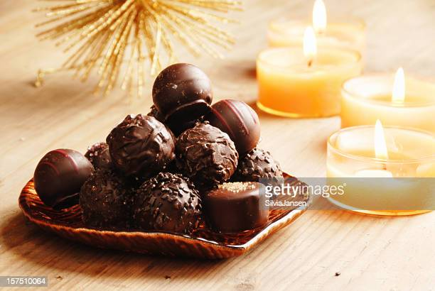 christmas chocolate truffles and candles - 2000 2009 stock pictures, royalty-free photos & images