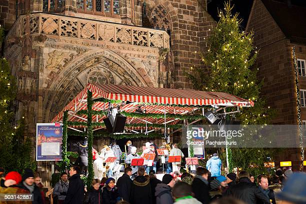 Christmas choir in front of the Church of our Lady in the Christmas market of Nuremberg.