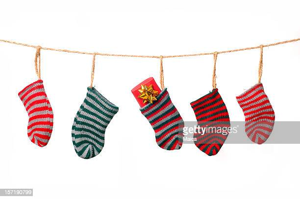 christmas clothesline - christmas stocking stock photos and pictures