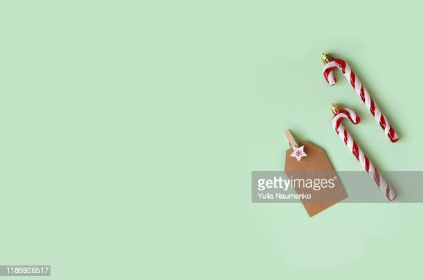 christmas collection, decorations and new year decorative ornaments on green background. - candy dolls fotografías e imágenes de stock