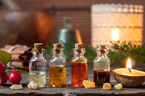 Christmas collection of essential oils with frankincense, wintergreen and candles 1076040088