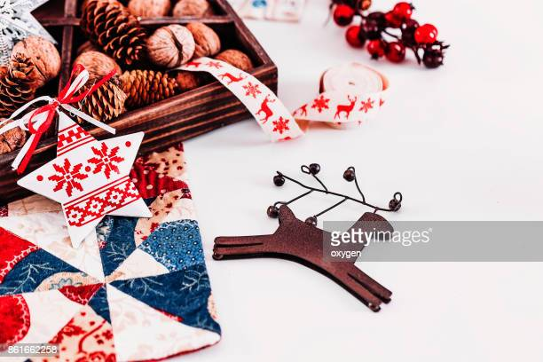 Christmas composition with brown elk toy on white background