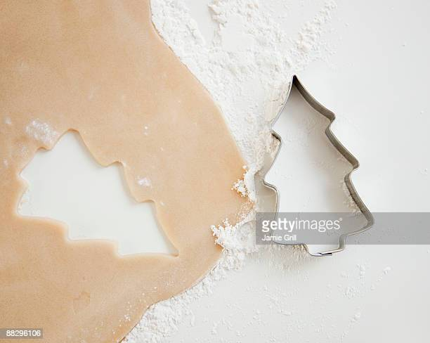 Christmas cookie cutter and dough