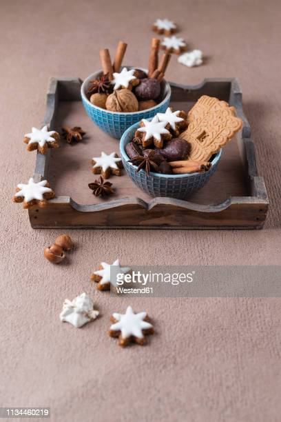 christmas cookies, nuts and spices - anice foto e immagini stock