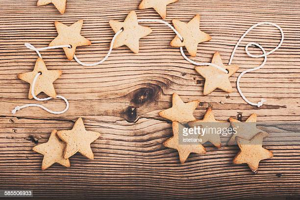 Christmas cookies on wooden background, top view