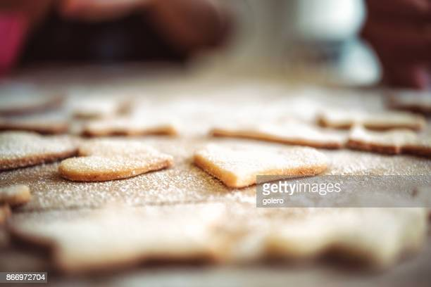 christmas cookies on wooden table - biscuit stock photos and pictures