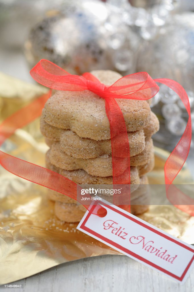 Christmas cookies tied with red ribbon : Stock Photo