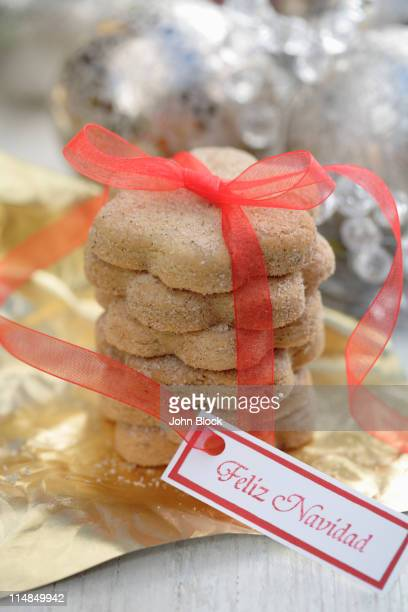 christmas cookies tied with red ribbon - feliz navidad stock photos and pictures