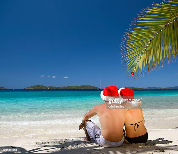 christmas couple at a caribbean tropical beach - caribbean christmas stock pictures, royalty-free photos & images