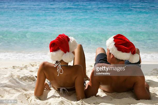 christmas couple on beach - caribbean christmas stock pictures, royalty-free photos & images