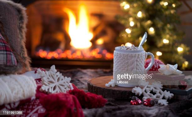 christmas cozy hot chocolate in front of the fireplace - cosy stock pictures, royalty-free photos & images