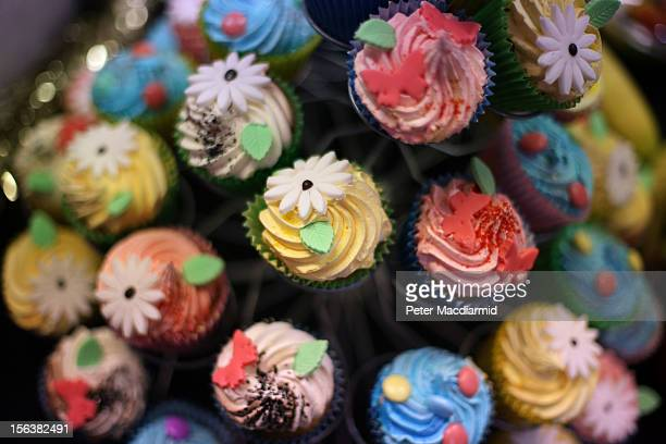 Christmas cup cakes are displayed for sale at The Ideal Home Christmas Show on November 14 2012 in London England Over 400 exhibitors are showcasing...