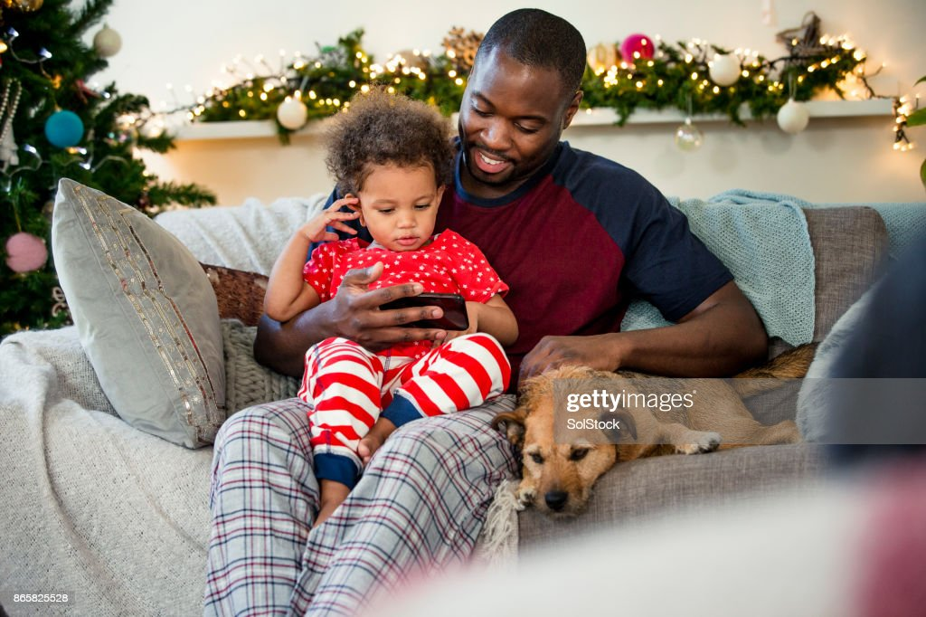 Christmas Day with his Little Girl : Stock Photo