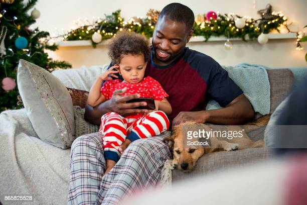 christmas day with his little girl - winter home stock photos and pictures