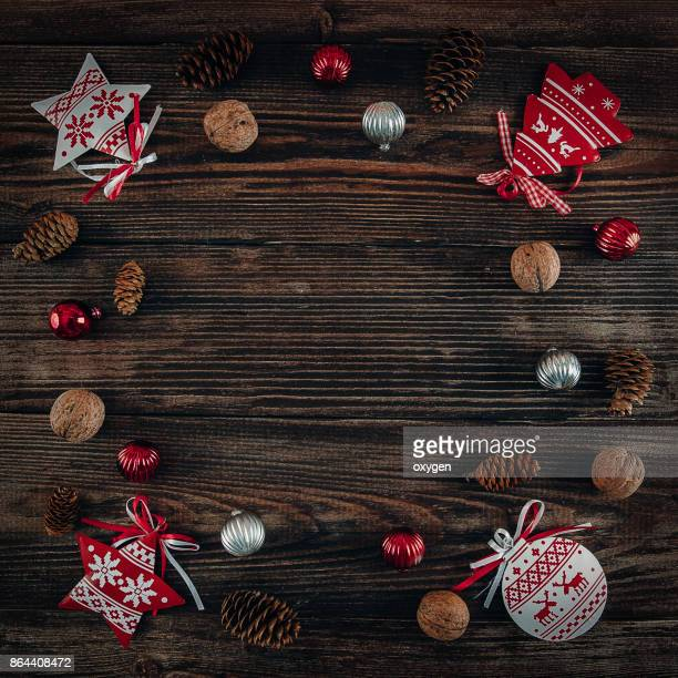Christmas Decor with Copy Space on Centre Dark Wooden Background