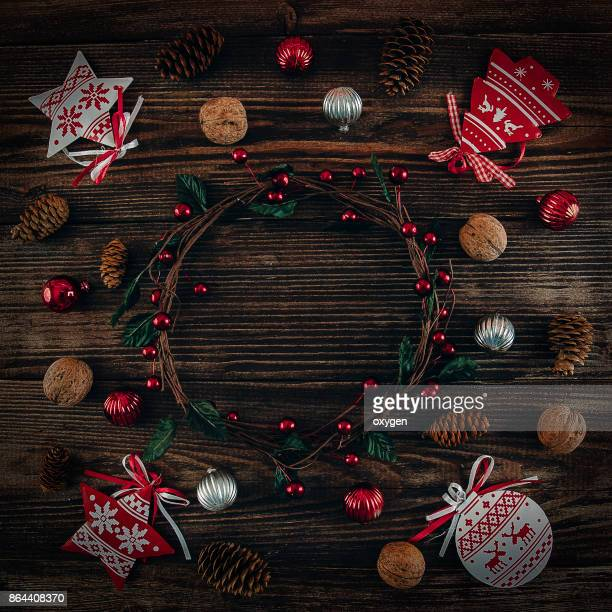 Christmas Decor with Wreath on Centre on Dark Wooden Background
