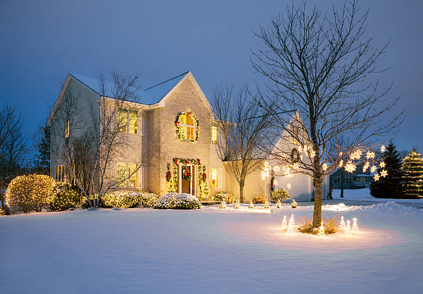 christmas decorated home with holiday lighting, snow - house stock pictures, royalty-free photos & images