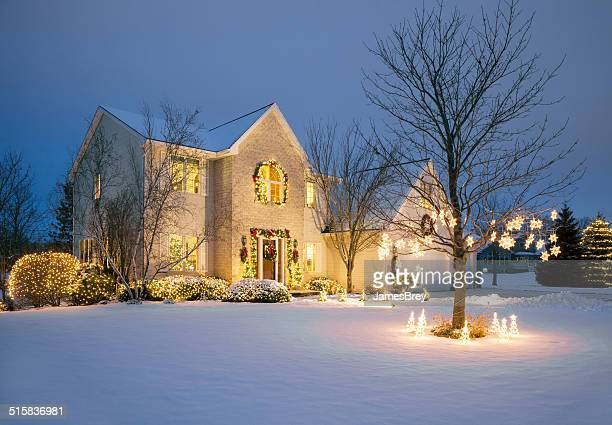 christmas decorated home with holiday lighting, snow - illuminate stock photos and pictures