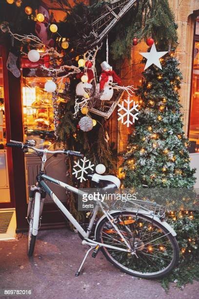 christmas decorated street and bicycle - colmar stock photos and pictures
