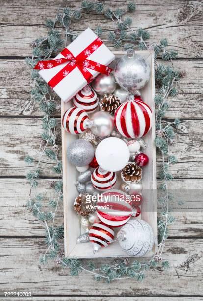 Christmas decoration and Christmas present on wood bowl