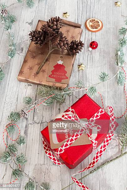 Christmas decoration and wrapped presents on wood