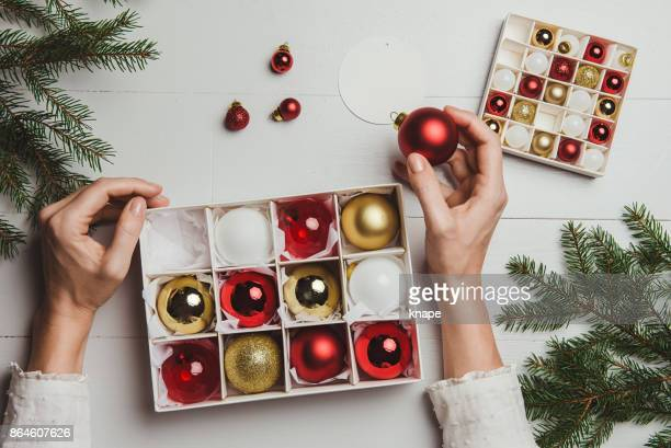 christmas decoration from above overhead with woman hands - country christmas stock pictures, royalty-free photos & images