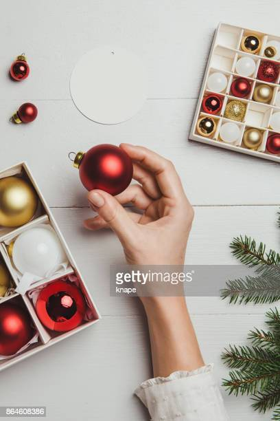 Christmas decoration from above overhead with woman hands