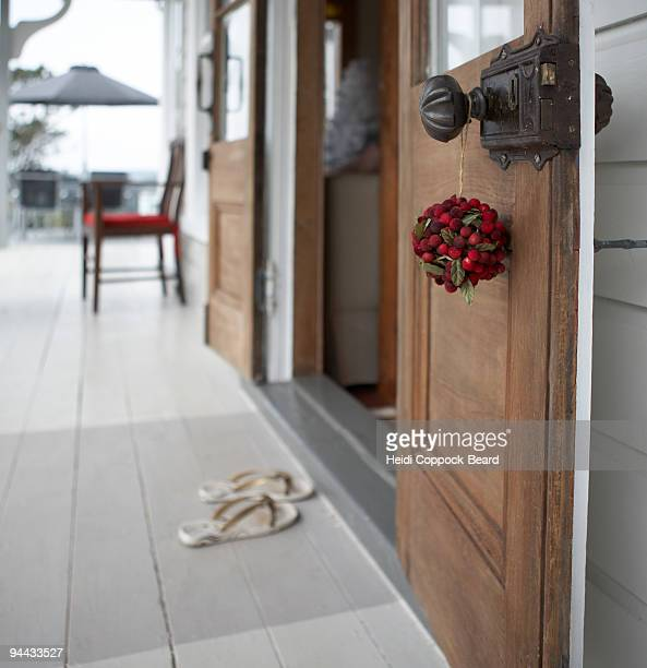 christmas decoration hanging on door handle - heidi coppock beard stock pictures, royalty-free photos & images