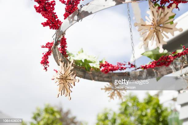 A christmas decoration hangs outside in the sunshine
