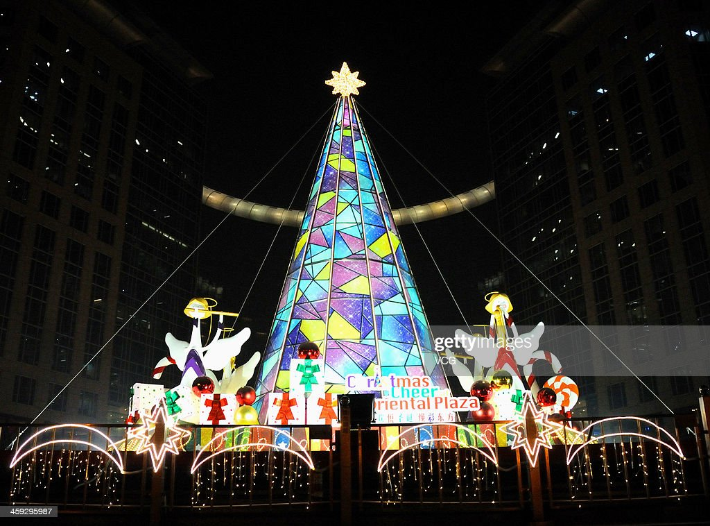 A Christmas decoration is illuminated at Oriental Plaza on December 24, 2013 in Beijing, China.