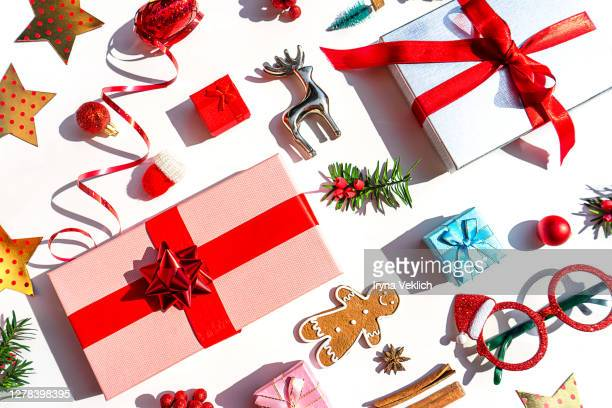 christmas decoration objects and gift box as holiday background. - gifts stock pictures, royalty-free photos & images