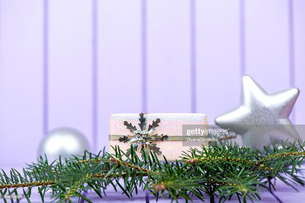 Christmas decoration on a purple striped background - selective : Photo